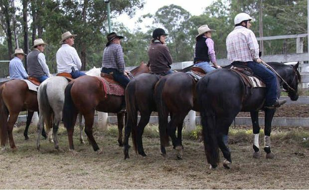 Riders line up to watch the action at the Gunalda Campdraft.