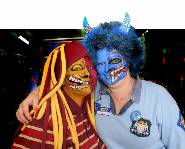 Workmates Dianne Fogarty and Teegan Cairns don't see eye to eye when it comes to origin.