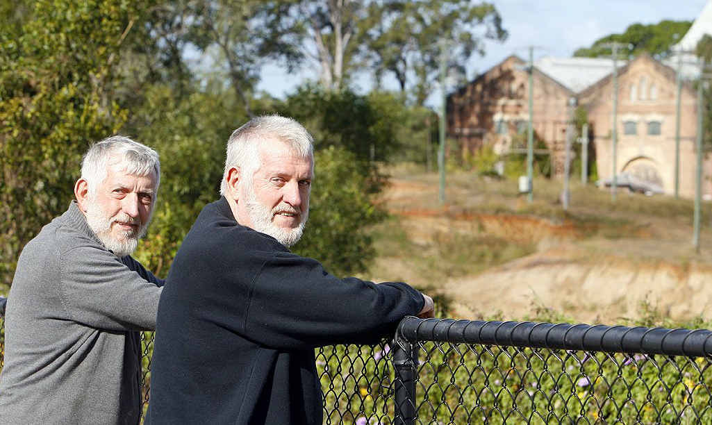 Len and Keith Harris look over the fence towards the Ipswich Railway Workshops, where Keith trained and worked as an apprentice. Filming is due to begin today on The Railway Man.