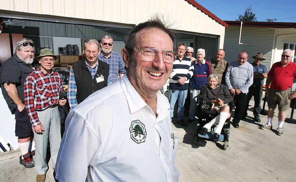 Rosewood Men's shed convenor Denis Hawkins with supporters of the Men's Shed in Rosewood.