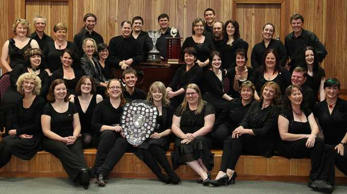 Members of the Contemporary Choral choir celebrate their recent success at the Toowoomba Eisteddfod.