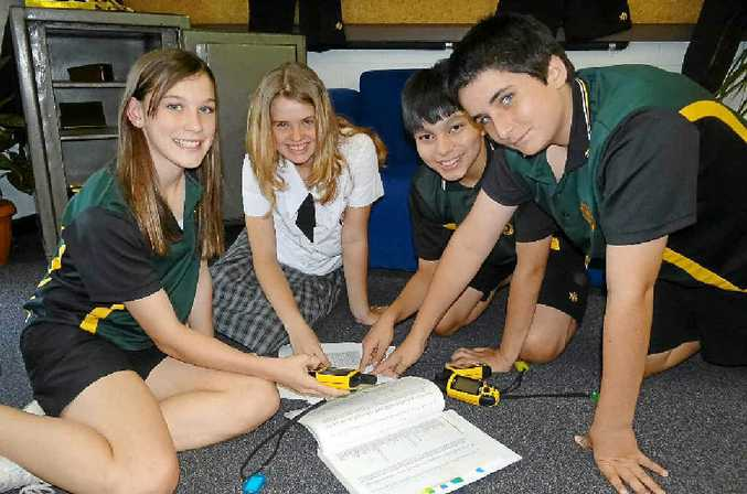 QUIET ACHIEVERS: James Nash Year 8 students Karlie Browne, Eliza Parker, Lance Miller and Mitchell Swift check out some of the activities involving geocaching instruments on offer to visiting Year 7s on Saturday.