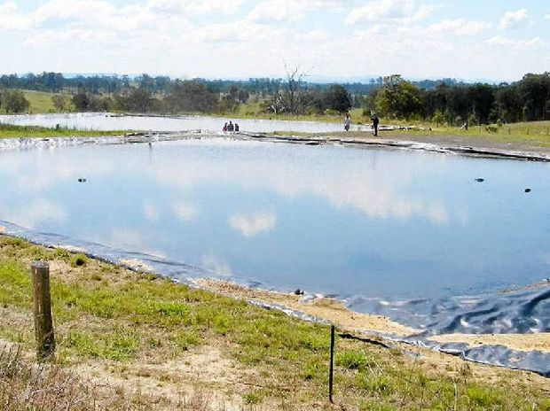 A holding pond for produced water.