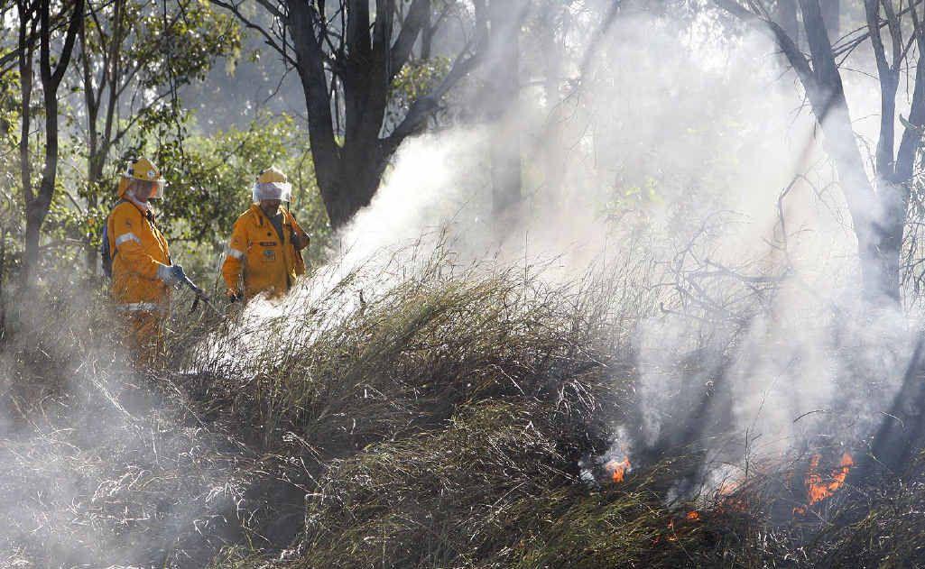QFRS teams conduct back burning at Ironbark, by the Warrego Hwy.