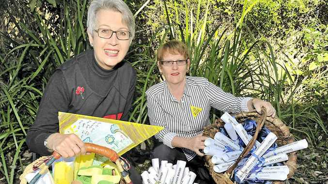 Lismore mayor Jenny Dowell and Annie Kia holding the baskets full of CSG Free Community declarations.