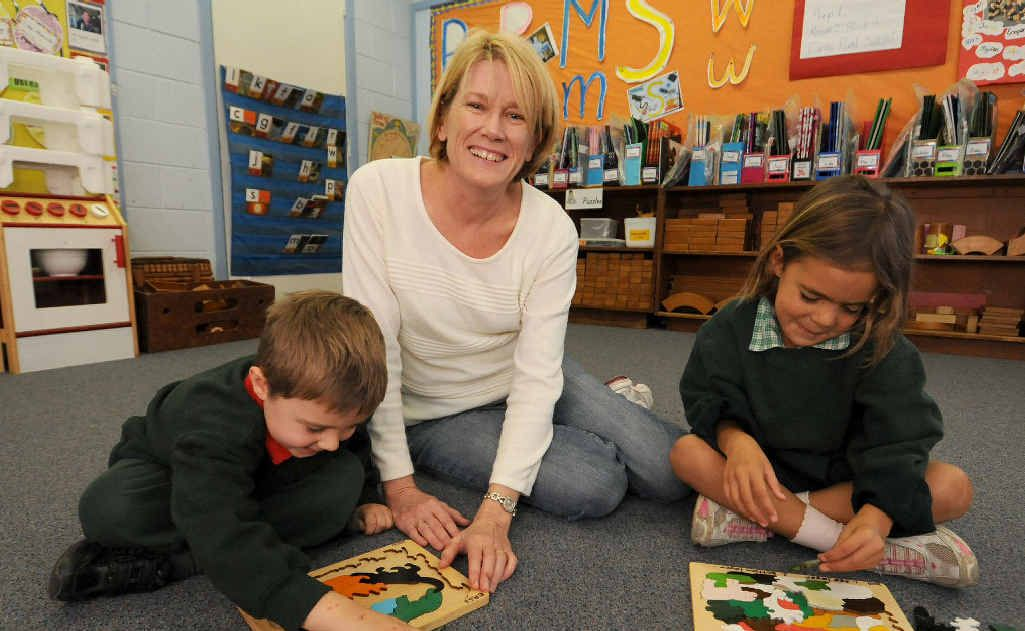 Eimeo State School students Nikolas Refalo and Jorja Bell with teacher Linda Vella, who has been nominated for Australian Early Childhood teacher of the Year.