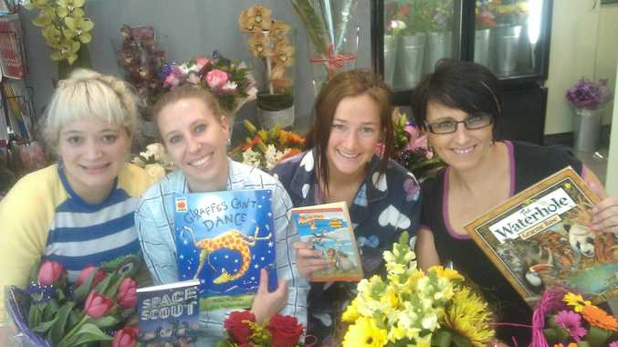 Preparing for Pyjama Day are Blooming Gorgeous staff members (from left) Elizabeth Zoet, Andrea McCullagh, Holly Lien and Sally Harvey.