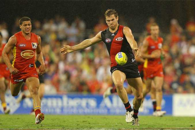 Stewart Crameri of the Bombers kicks during the round three AFL match between the Gold Coast Suns and the Essendon Bombers at Metricon Stadium on April 14, 2012 in Gold Coast, Australia.