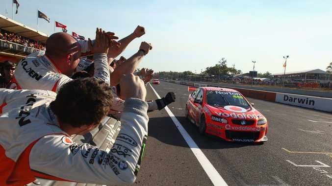Driver Craig Lowndes crosses the line to win race 13 of the V8 Supercars Championship Series at Hidden Valley Raceway on June 17.