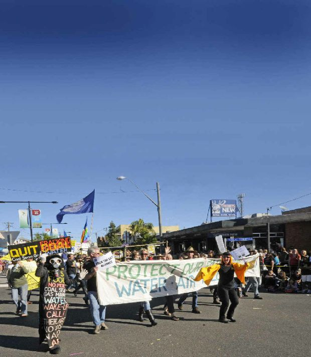 CSG protesters (above) marching in the 2012 Casino Beef Week parade and (top right and above left) outside Metgasco's office in Johnston Street, Casino, including Jasmine Whyte (above right) of Goonengerry. Metgasco (top left) CEO Peter Henderson, left, and external relations manager Richard Shields at the company's Dobies Bight site, and Metgasco supervisors (above right, centre) monitoring the dismantling of a rig.