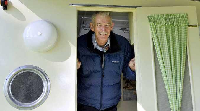 Jim Robertson displays his restored 1962 Sunshine caravan.