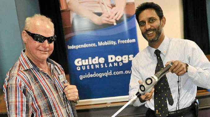 Bundaberg Blind and Vision Impaired Peoples Friendship Club president Graeme Raines checks out what's on offer at the Mobility Expo with Guide Dogs Queensland rehabilitation services manager Bashir Ebrahim.