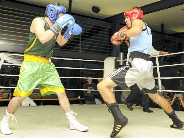 Yamba boxer Keaton Rheinberger (blue singlet) took the North Coast 71kg title against Dorrigo boxer Daniel Glanville (green) at the Yamba Shores Tavern on Saturday night.