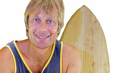 Tom Wegener works on an Alaia surfboard.