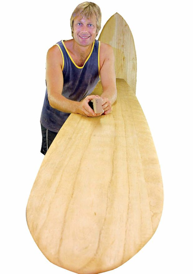 Tom Wegener works on an Alaia surfboard.