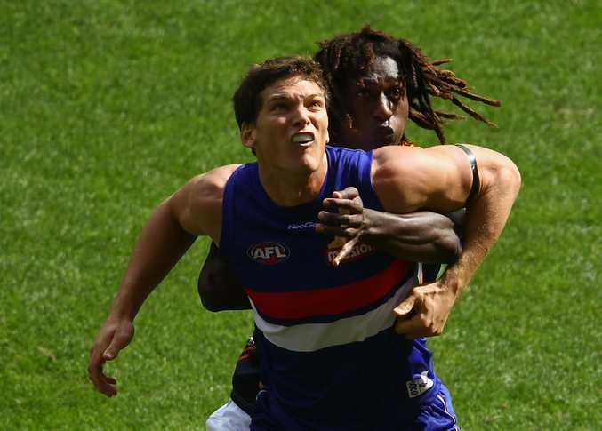 Will Minson (front) of the Bulldogs is challenged by Nic Naitanui of the Eagles during an AFL match. Minson will miss the team's next game against the Lions.