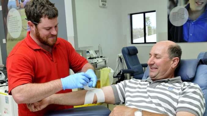 Red Cross Blood Service enrolled nurse Alex Skewes relieves Rick Snep of a few litres of much-needed blood.