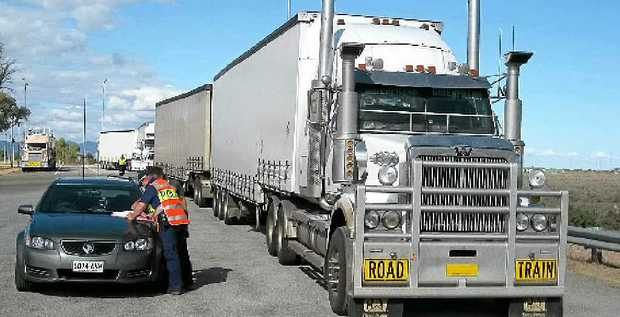 CAUGHT: Police intercept a driver who tested positive to meth, as a part of Austrans. The truck's speed limiter had also been tampered with and the tyres were defective.