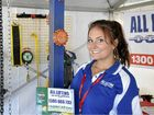 An enthusiastic Kristie Lee represents All Lifting Equipment at the expo.