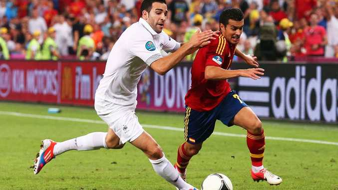 Adil Rami of France battles with Pedro of Spain during the UEFA EURO 2012 quarter final match between Spain and France at Donbass Arena in Donetsk, Ukraine.