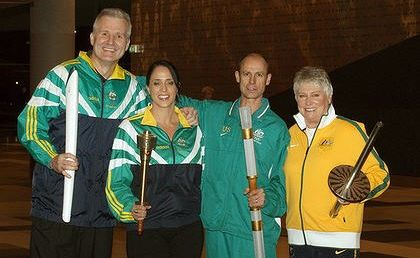Andrew Gaze, Nicole Livingstone, Steve Moneghetti and Raelene Boyle pose with Olympic torches past at last night's function.