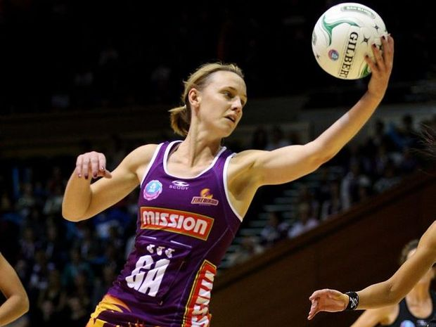 Natalie Medhurst of the Firebirds reaches for the ball during the round 13 ANZ Championship match between the Firebirds and the Fever at Brisbane Convention & Exhibition Centre on June 24, 2012 in Brisbane, Australia.