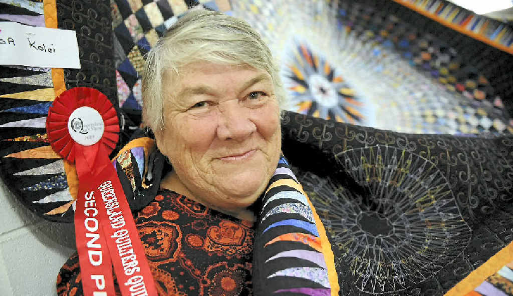Ailsa Koloi shows off her award-winning quilt at the occasion.