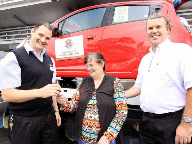 Winner of a new car, June Tonkin, 70 is pictured with Gregs IGA partners Derek Hutchinson and Greg Tierney. She will be presented with her new wheels on Monday.