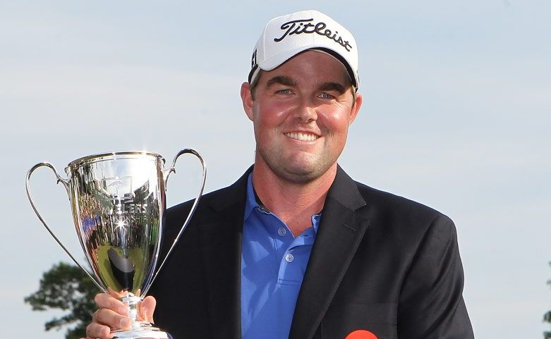 Marc Leishman of Australia holds the trophy after winning the 2012 Travelers Championship at TPC River Highlands on June 24, 2012 in Cromwell, Connecticut.
