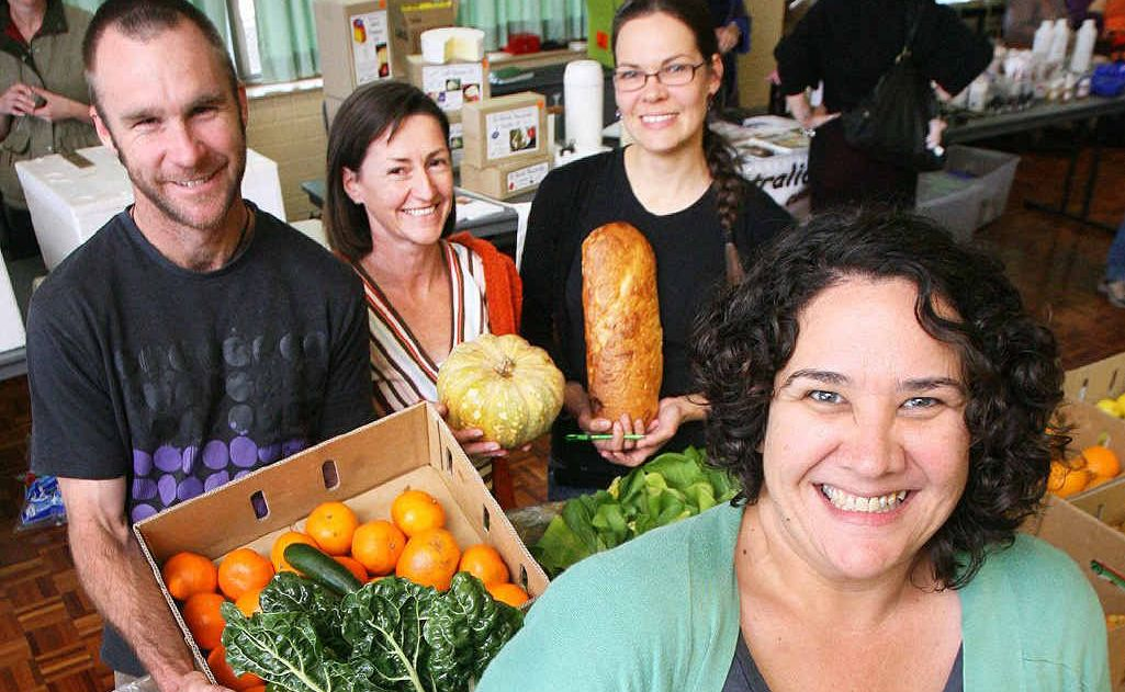 Volunteers Ruth Farrell (front) with Robert Nitschke, Megan Collis and Angela Salisbury at the Ipswich Good Food Co-op held at the South Street Club on Sunday.