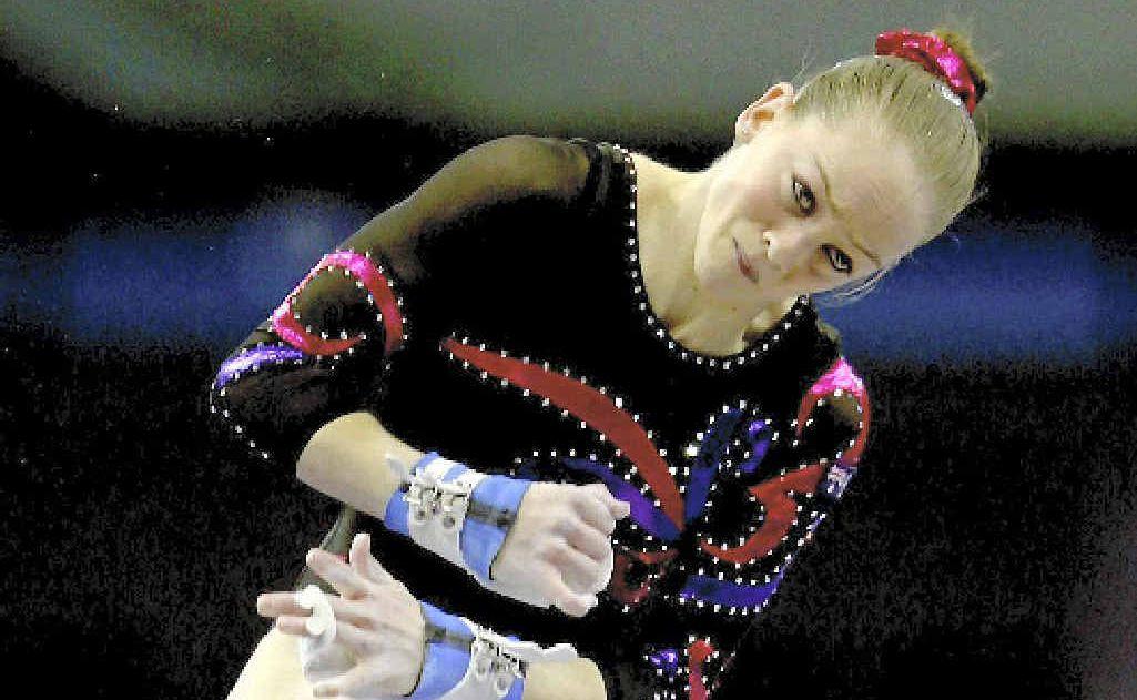 Gymnast Larrissa Miller, in action on the uneven bars, started her career in Moranbah.