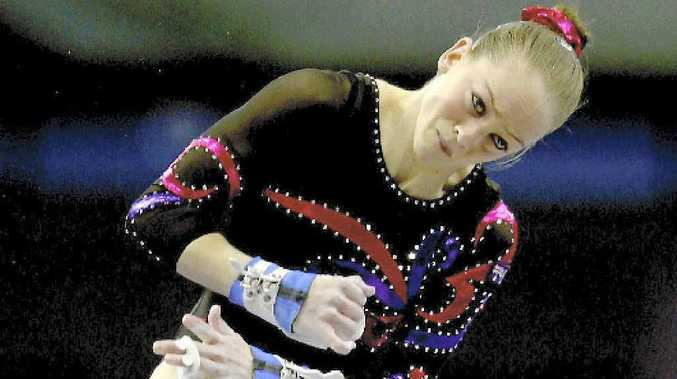 Gymnast Larrissa Miller, in action on the uneven bars, started her career in Moranbah.