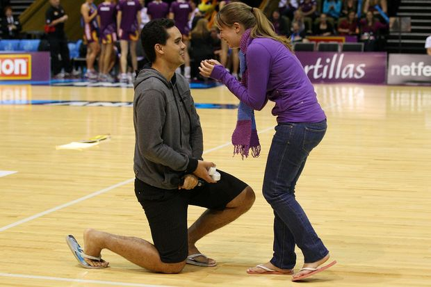 Edmond D'Albret proposes to Katherine Miles during the round 13 ANZ Championship match between the Firebirds and the Fever at Brisbane Convention & Exhibition Centre on June 24, 2012 in Brisbane, Australia.