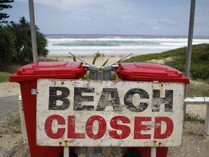 Beaches shut as big surf rolls in