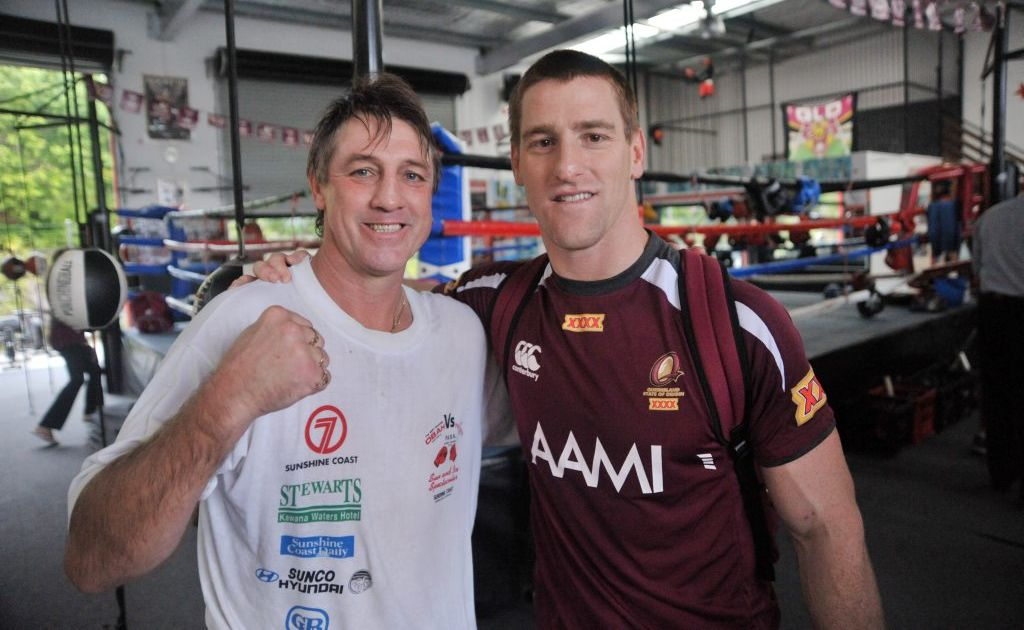 The Maroons' Brent Tate, right, rubs shoulders with Darren Obah at the former professional boxer's gym at Kunda Park.