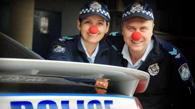 Gympie Police Sergeant Kylie McCellan and Senior Constable Brett Stoward don their red noses in support of SIDS and Kids Queensland.