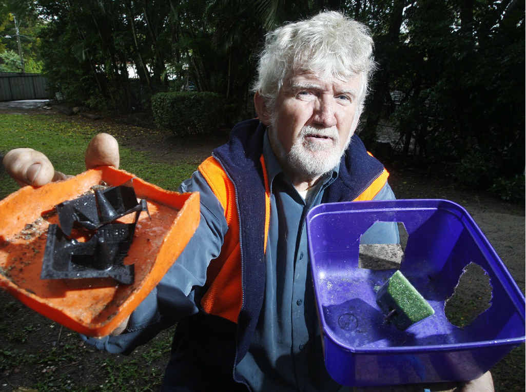 Keiron Butler with his rat bait at his Goodna home. He spends $12 a week on baits to try and keep the rodents at bay.
