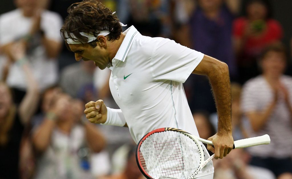Roger Federer of Switzerland celebrates set point during his Gentlemen's Singles third round match against Julien Benneteau of France on day five of the Wimbledon Lawn Tennis Championships .