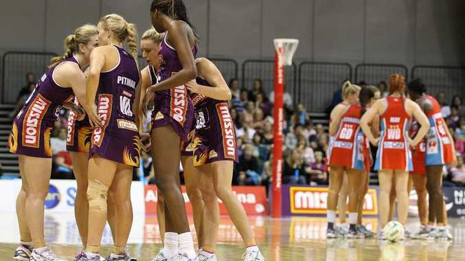 Firebirds and Swifts huddle during a timeout in the round 10 ANZ Championship match between the Firebirds and the Swifts at Brisbane Convention & Exhibition Centre on June 3, 2012 in Brisbane, Australia.