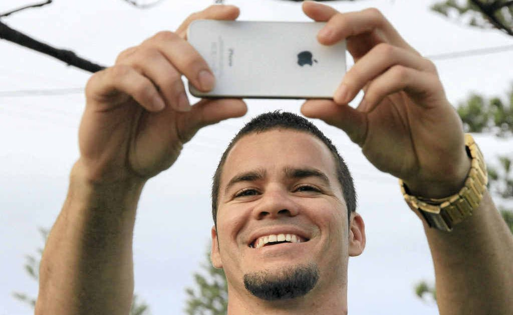 Yaegl man Jack Purcell of Yamba takes a photo of himself to forward to a casting agency looking for indigenous people to take part in a new ABC drama series.