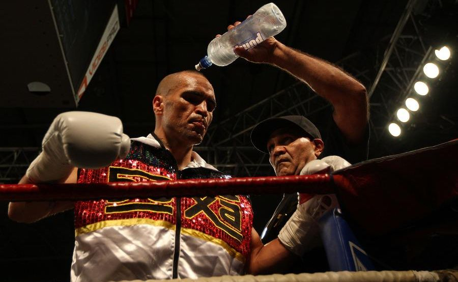 Tony Mundine, Dad and trainer of Anthony Mundine (L) cools him down before his fight against Xavier Toliver of America during the Clash for Canterbury Fight Night on June 5, 2011 in Auckland, NZ.