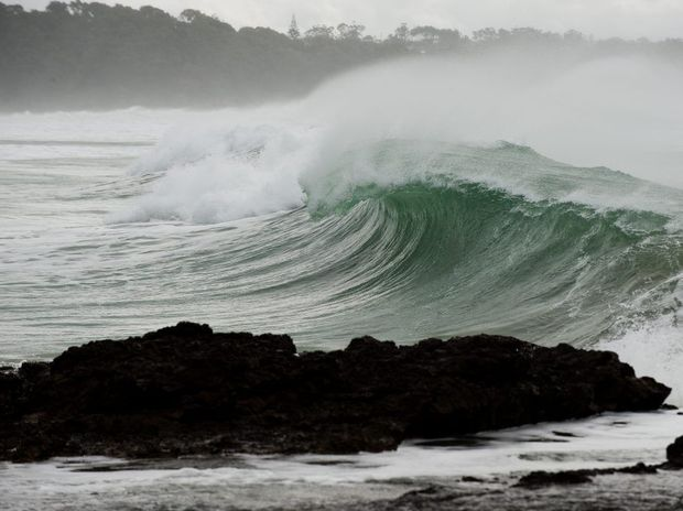 Former Tropical Cyclone Ola to whip up waves along the south-east Queensland coast.