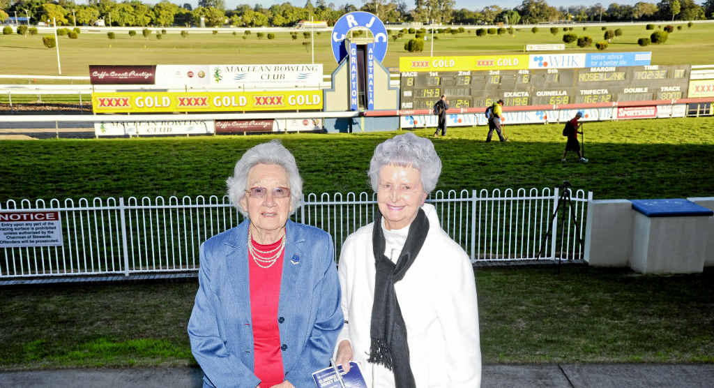Marie Connolly and Claire Henry look over the finish line at the Grafton Racecourse.
