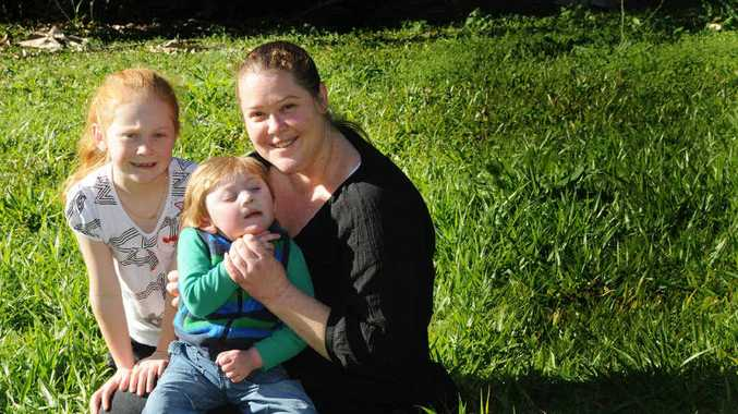 Kyla Reen with children Ebony and Issac, will benefit from a Nestle Gympie donation towards an insulin pump.