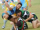 Gympie Devils centre Ben Ashford tries to fight out of a low Mary Valley Stags tackle.