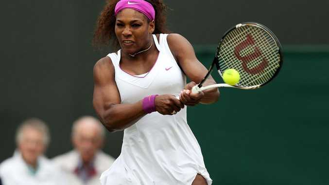Serena Williams hits a backhand return during her Ladies' singles fourth round match against Yaroslava Shvedova on day seven of the Wimbledon Lawn Tennis Championships.