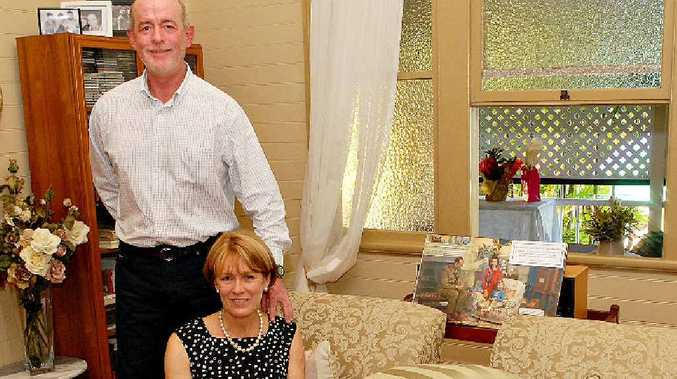 Bruce and Vicki Heggie inside their 100-year-old James St home. They held a garden party for friends and relatives on Sunday to celebrate the milestone.
