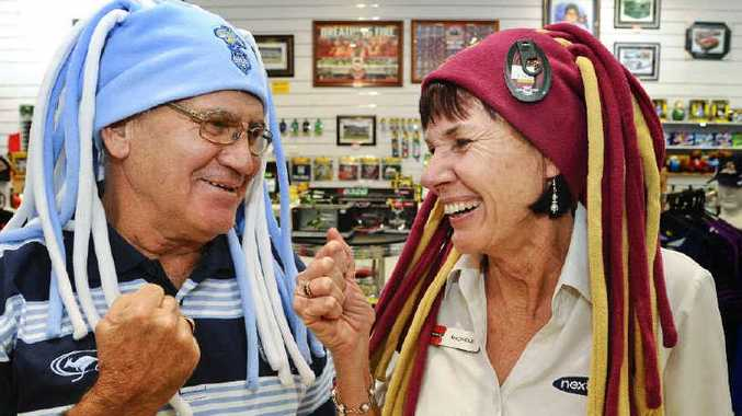 Keith Harris of Footy Fever and Michele Johnstone of nextra newsagency show their State of Origin colours ahead of tonight's anticipated deciding match at Suncorp Stadium in Brisbane.