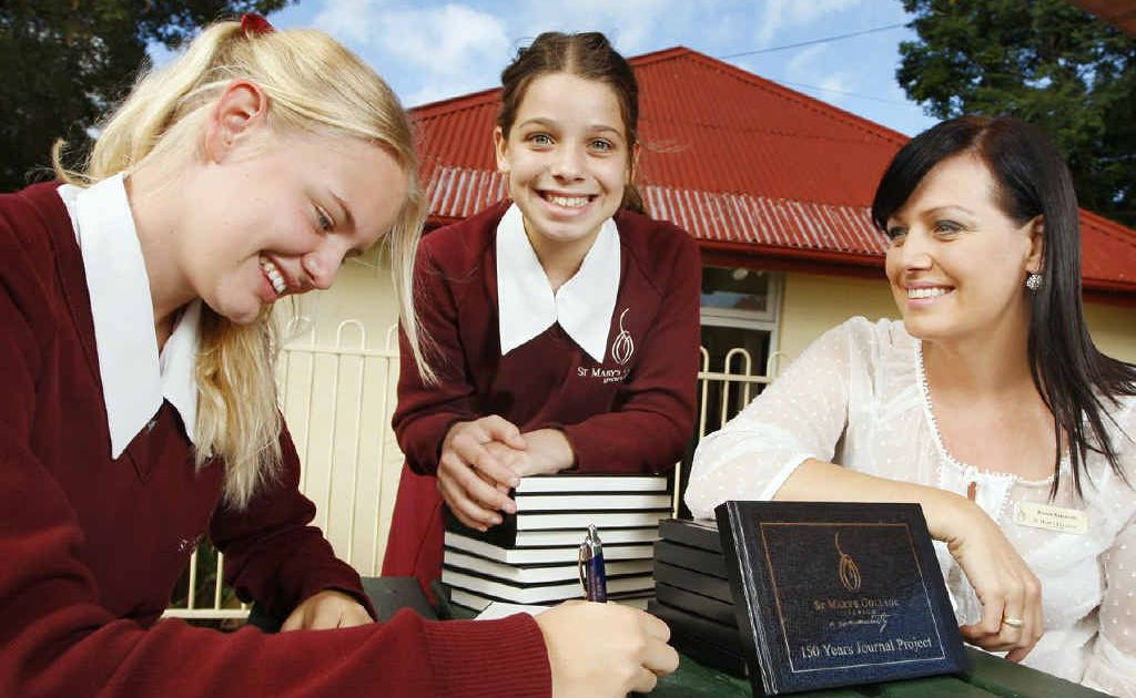 St Mary's College enrolment registrar Karina Antoniolli (right) with her daughter, Year 8 student Emason Antoniolli (centre), and niece, Year 9 student Lilly Vince, who will write journals for the 150th year celebrations.