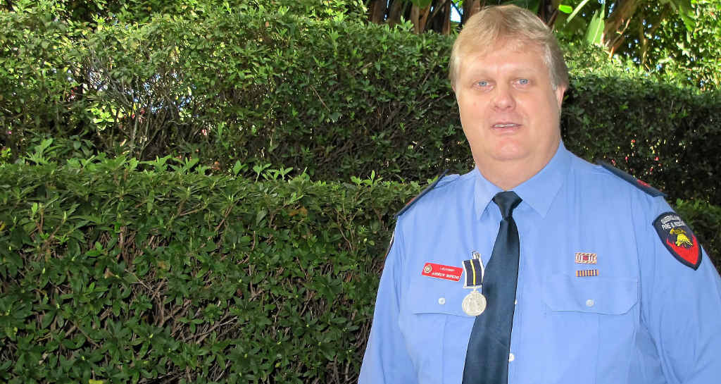 Yarraman auxiliary fire officer Andrew Hopkins was awarded a silver medal for rescuing a man from a flooded house in 2011.